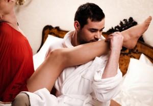 man kissing womans leg small