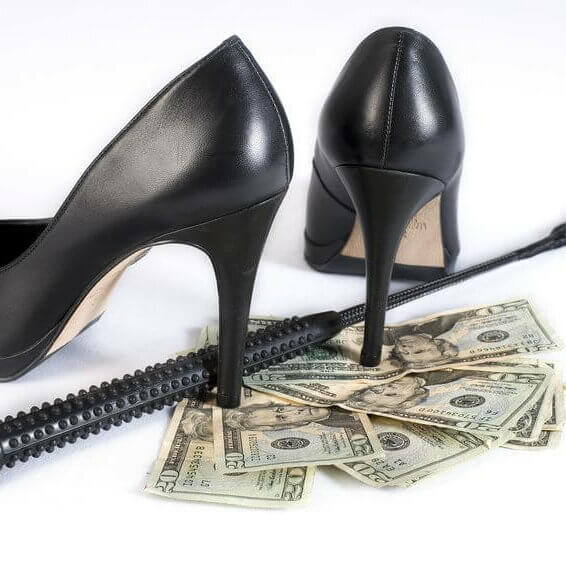 11187799 - strict black leather flogging whip, high heels shoes and money on white background. not isolated.